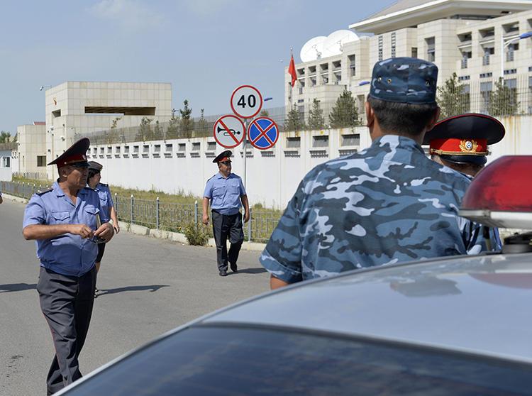 Kyrgyz police officers are seen in Bishkek on August 30, 2016. Kyrgyz journalist Bolot Temirov was assaulted today in Bishkek. (AP/Vladimir Voronin)
