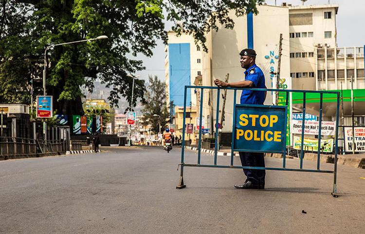 A police officer is seen in Freetown, Sierra Leone, on March 27, 2015. Journalists covering a local politician were recently attacked in two separate incidents in Sierra Leone. (AP/Michael Duff)