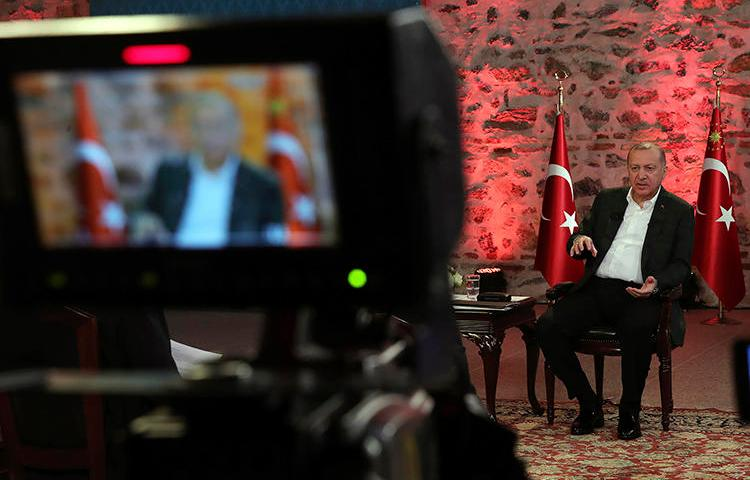 Turkish President Recep Tayyip Erdogan gives a televised interview in Istanbul on January 5, 2020. The Turkish government recently cancelled hundreds of journalists' press passes. (Presidential Press Service via AP)