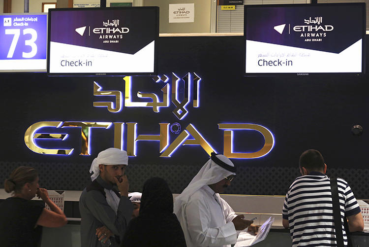 Abu Dhabi International Airport is seen on July 4, 2017. Serbian journalist Stevan Dojčinović was recently denied entry to the United Arab Emirates. (AP/Jon Gambrell)