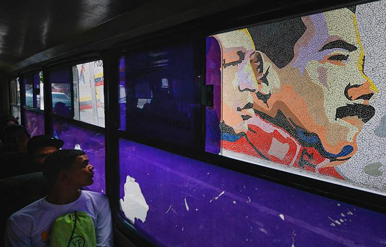A mosaic of late leader Hugo Chavez and President Nicolas Maduro is seen in Caracas, Venezuela, on December 19, 2019. Venezuelan authorities recently released freelance photojournalist Jesús Medina after 16 months of detention. (AP/Matias Delacroix)