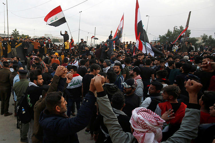 Iraqi demonstrators gather in Basra on January 10. Gunmen killed two journalists from the Iraqi broadcaster Dijlah TV, who were covering the protests. (Reuters/Essam al-Sudani)
