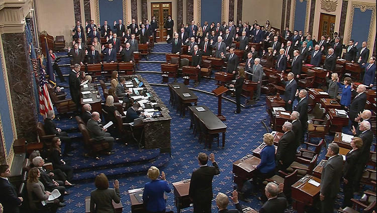 Chief Justice of the United States John Roberts swears in senators during the procedural start of the Senate impeachment trial of U.S. President Donald Trump in this frame grab from video shot in the Senate Chamber at the U.S. Capitol in Washington, D.C., on January 16, 2020. CPJ and 57 news organizations asked the Senate to rethink press restrictions during the impeachment trial. (Reuters/U.S. Senate TV/Handout via Reuters)