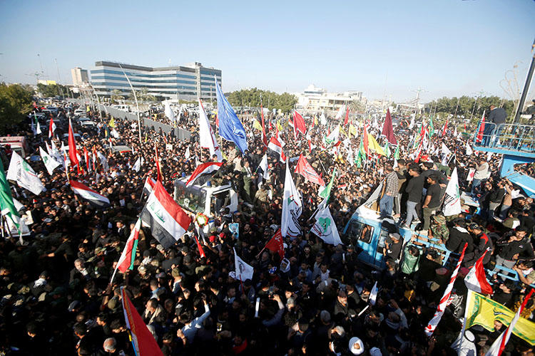 Iraqis gather in Basra, Iraq, during a funeral procession on January 7, 2020, for militia commander Abu Mahdi al-Muhandis, who was killed by a U.S. airstrike at Baghdad airport. (Reuters/Essam al-Sudani)