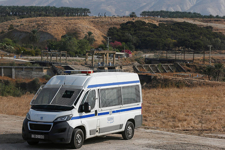 A Jordanian police vehicle is seen near the Israeli border on November 13, 2019. Jordanian authorities recently suspended broadcaster Dijlah TV, and the station's offices in Iraq were raided by local authorities. (Reuters/Muhammad Hamed)