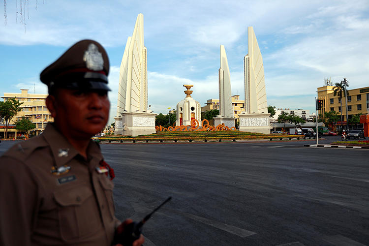 A police officer is seen in Bangkok, Thailand, on May 2, 2019. A Thai court recently sentenced journalist Suchanee Cloitre to two years in jail for criminal defamation. (Reuters/Soe Zeya Tun)