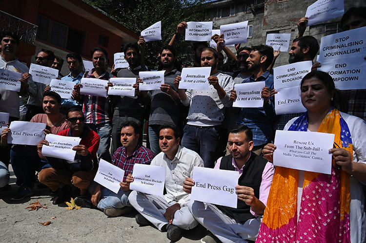 Journalists protest against restrictions of the internet and mobile phone networks at the Kashmir Press Club in Srinagar in October 2019. Jammu and Kashmir police have questioned three journalists this month, and internet access has yet to be fully restored. (AFP/Tauseef Mustafa)