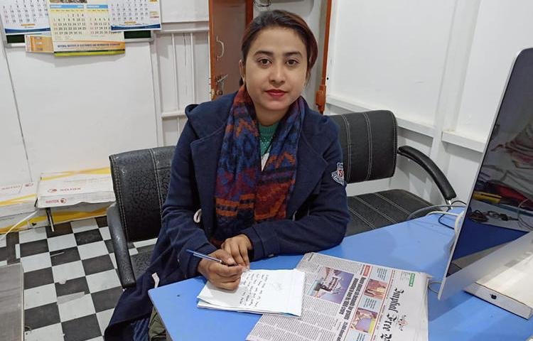 Journalist Babie Shirin is pictured in the office of the Imphal Free Press newspaper. The chief minister of Manipur accused the publication of criminal defamation in relation to an article Shirin wrote in 2018. (IFP/Telheiba)
