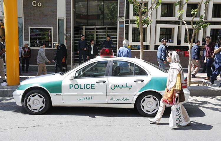 An Iranian police vehicle is seen in Tehran on April 10, 2018. Iranian authorities recently convicted three editors on defamation and false news charges. (AFP/Atta Kenare)
