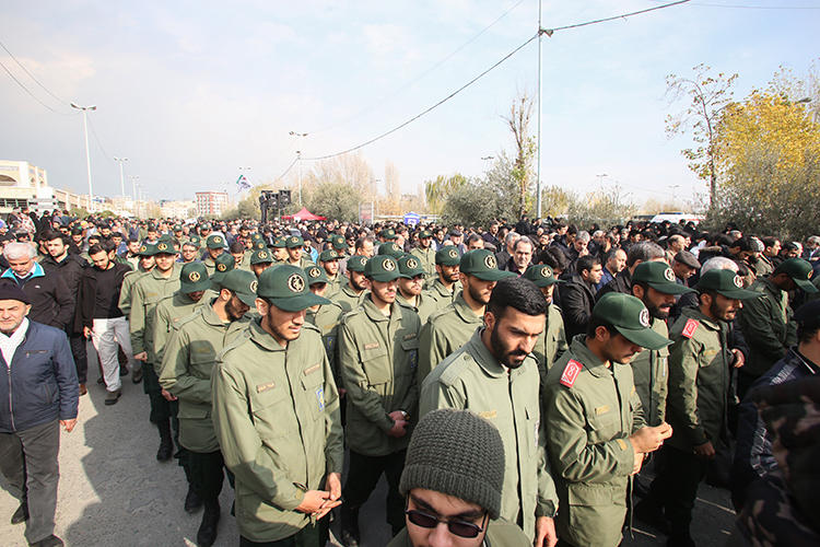 Members of Iran's Islamic Revolutionary Guard Corps are seen in Tehran on January 3, 2020. Intelligence agents recently raided the homes of four journalists. (AFP/Atta Kenare)
