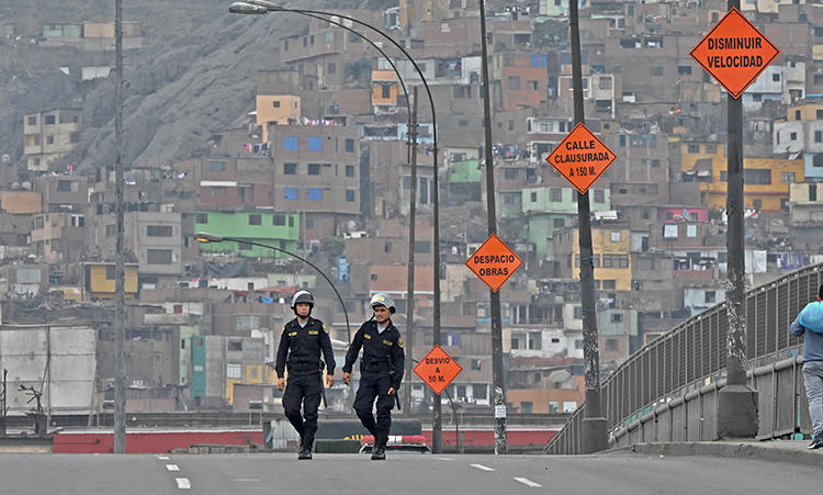 Police are seen in Lima, Peru, on October 1, 2019. Journalist Daysi Lizeth Mina Huamán recently went missing in Peru. (AFP/Cris Bournoncle)