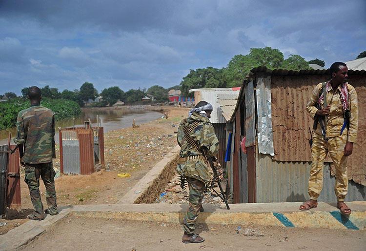 Somalia's soldiers patrol in Afgooye, some 30 km south of the Somali capital, Mogadishu, on October 19, 2016. Somali broadcast journalist Abdiwali Ali Hassan was gunned down in Afgooye on February 16, 2020. (AFP/Mohamed Abdiwahab)
