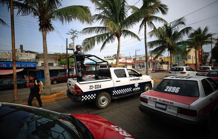 A state police truck patrols in Coatzacoalcos, Veracruz state, Mexico, on August 30, 2019. Mexican police attacked reporters during a protest in Ciudad Isla, Veracruz, on February 11, 2020. (AP Photo/Rebecca Blackwell)
