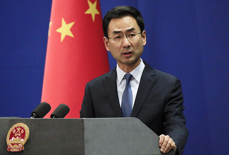 Chinese Foreign Ministry spokesperson Geng Shuang speaks in Beijing on January 29, 2019. Geng announced today that three Wall Street Journal journalists will be expelled from the country. (AP/Andy Wong)
