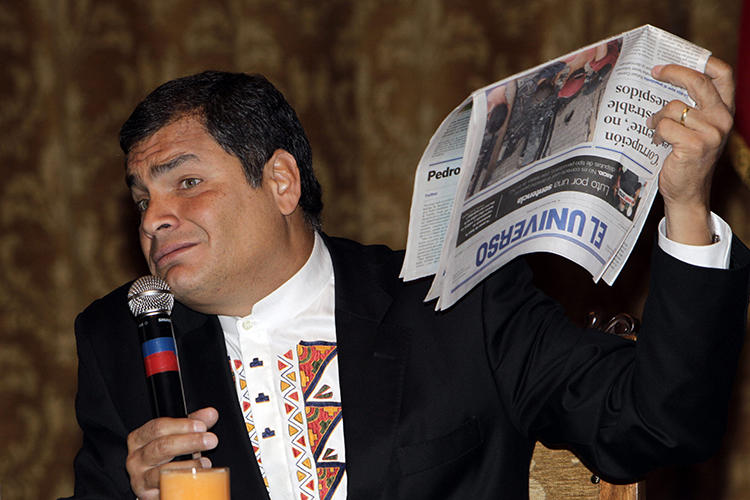 Ecuadorian President Rafael Correa holds up a copy of El Universo in Quito on November 22, 2011. The newspaper's case against Ecuadorian authorities was recently accepted by the Inter-American Court of Human Rights. (AP/Dolores Ochoa)