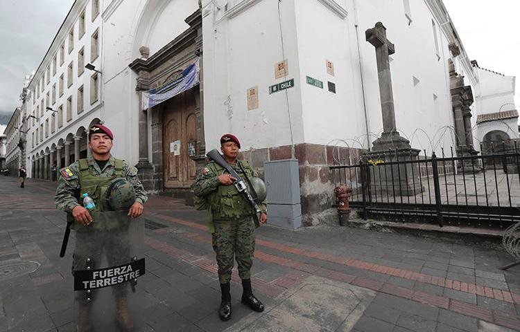 Soldiers are seen in Quito, Ecuador, on October 17, 2019. Ecuadorian journalist Andrés Mendoza recently received a death threat. (AP/Dolores Ochoa)