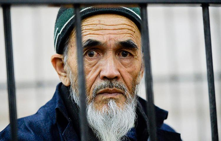 Journalist Azimjon Askarov is seen at a court in Bishkek, Kyrgyzstan, on October 11, 2016. The country's Supreme Court is set to hear Askarov's appeal tomorrow. (AP/Vladimir Voronin)