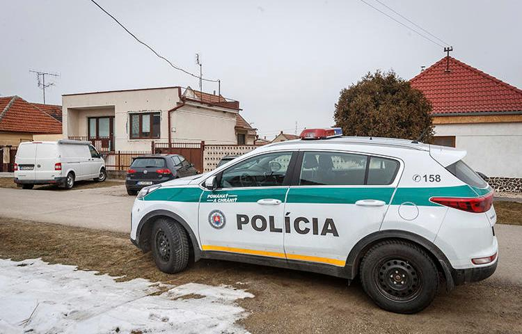 A police car is seen in Velka Maca, Slovakia, on February 27, 2018. Slovak authorities recently charged journalist Michal Havran with criminal defamation and slander. (AP/Michal Smrcok/News and Media Holding)