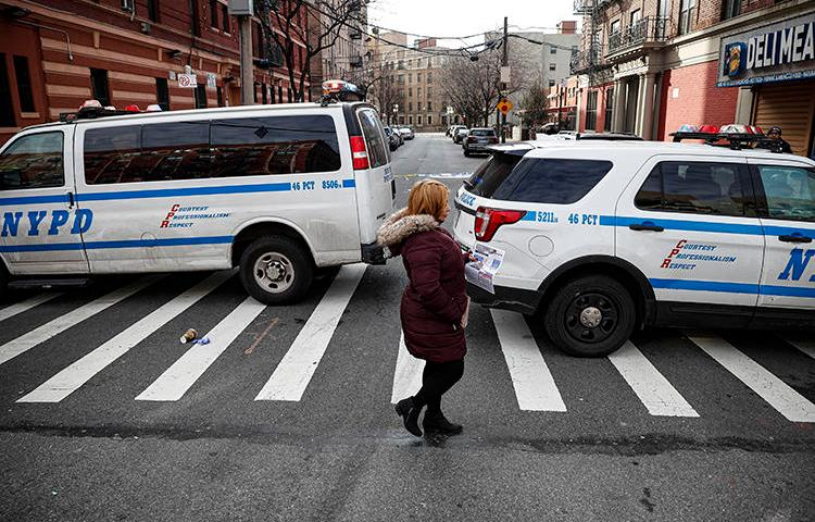 New York City police vehicles are seen on February 9, 2020. The NYPD recently cited anti-terrorism legislation in a subpoena seeking a journalist's data from Twitter. (AP/John Minchillo)