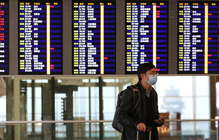A man is seen in Hong Kong International Airport on February 7, 2020. Immigration officials recently barred journalist Michael Yon from entering the city. (Reuters/Hannah McKay)