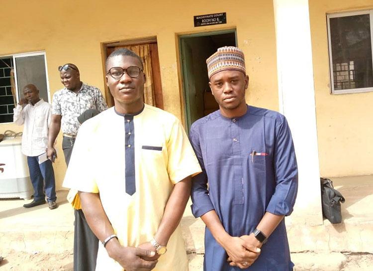 Alfred Olufemi (left) and Gidado Yushau (right) at court on January 13, 2020. (Photo: Adejumo Kabir/Premium Times)