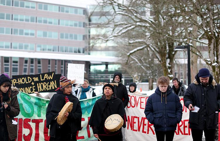 Supporters of the Wet'suwet'en Nation indigenous group, who oppose the construction of the Coastal GasLink pipeline, protest outside the provincial headquarters of the Royal Canadian Mounted Police (RCMP) in Surrey, British Columbia, Canada, on January 16, 2020. In early February, the RCMP prevented journalists from covering the takeover of an indigenous protest camp. (Reuters/Jesse Winter)