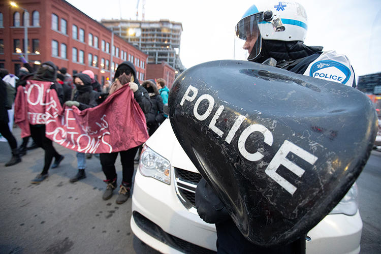 Police are seen at a demonstration of supporters of the indigenous Wet'suwet'en Nation in Montreal, Canada, on February 25, 2020. Canadian police recently arrested U.S. documentary filmmaker Melissa Cox. (Reuters/Christinne Muschi)