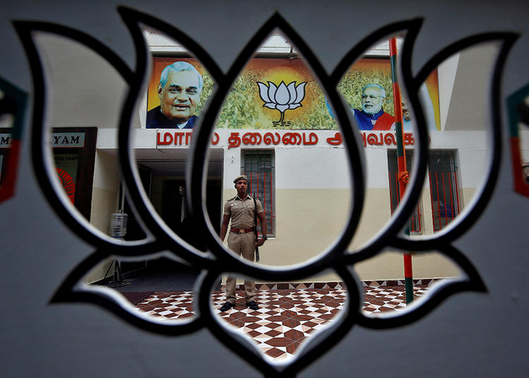 A police officer is seen at the office of India's ruling Bharatiya Janata Party in Chennai on November 9, 2019. BJP officials recently incited a harassment campaign against journalist Arfa Khanum Sherwani. (Reuters/P. Ravikumar)