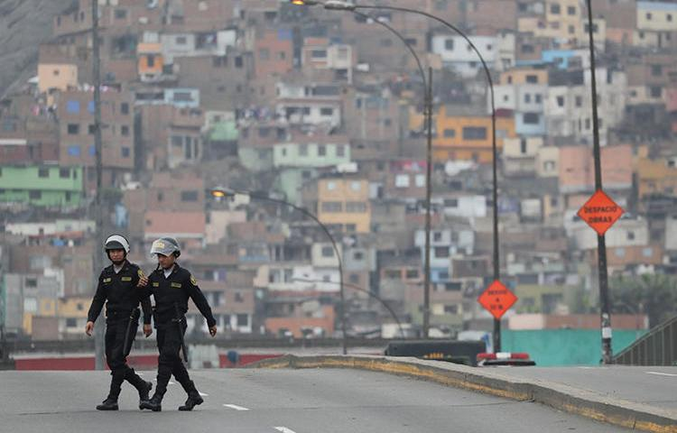 Police are seen in Lima, Peru, on October 1, 2019. Two journalists recently requested police protection after receiving threats and being surveilled. (Reuters/Guadalupe Pardo)