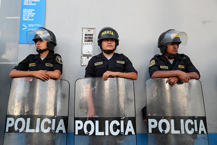 Police officers are seen in Lima, Peru, on March 19, 2019. Journalist Jimmy Alejandro Castillo Gamarra was recently assaulted in the town of San Marcos, in northern Peru. (Reuters/Guadalupe Pardo)