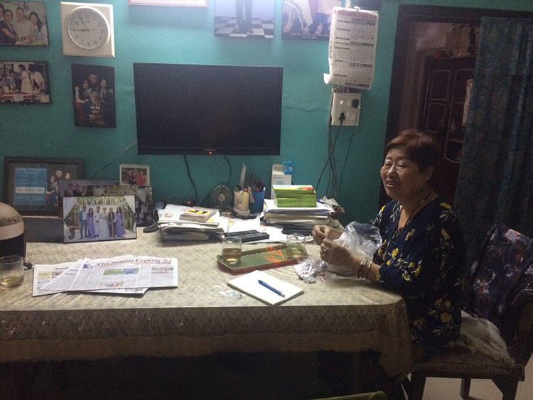 Journalist Valley Rose Hungyo sits at her dinner table in her home in Manipur, India. Hungyo recently talked to CPJ about running the only newspaper for Nagas in Manipur. (CPJ/Aliya Iftikhar)