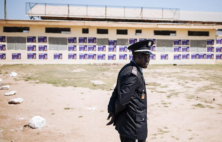 A police officer is seen in Cameroon's Far North Region on September 29, 2018. Journalist Adalbert Hiol has been jailed in Cameroon since November 2019. (AFP/Alexis Huguet)