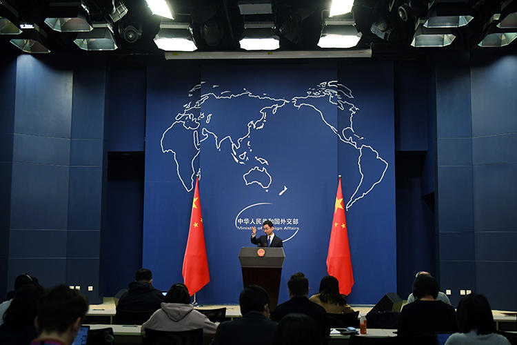 Chinese Foreign Ministry spokesperson Geng Shuang speaks during the daily press briefing in Beijing on March 18, 2020. China's Foreign Ministry recently announced it would take action to expel more than a dozen U.S. journalists. (AFP/Greg Baker)