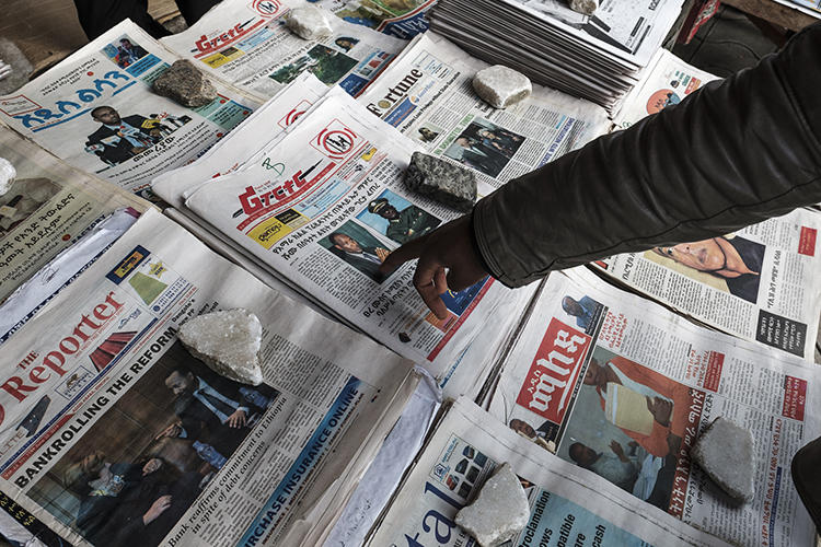 Newspapers are seen in Addis Ababa, Ethiopia, on June 24, 2019. Police recently arrested two journalists and their driver in Burayu, a town in the Oromia region. (AFP/Eduardo Soteras)