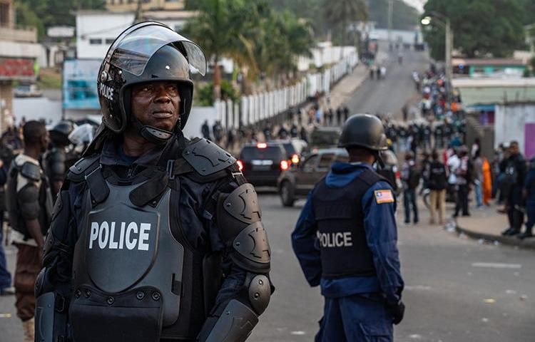 Police are seen in Monrovia, Liberia, on January 6, 2020. Police recently arrested journalist Kolubah Bobo Akoi over his Facebook posts. (AFP/Carielle Doe)