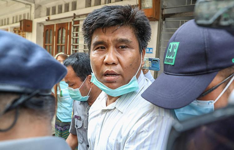 Voice of Myanmar editor-in-chief Ko Nay Lin is escorted by police to court in Mandalay, Myanmar, on March 31, 2020. He is facing life in prison on terrorism charges for his reporting. (AFP/Zaw Zaw)