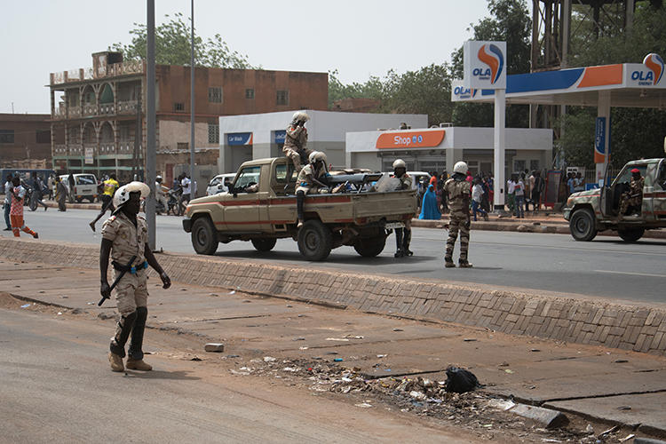 Security forces are seen in Niamey, Niger, on March 15, 2020. Police recently arrested journalist Kaka Touda Mamane Goni over his posts on social media about the COVID-19 pandemic. (AFP/Boureima Hama)