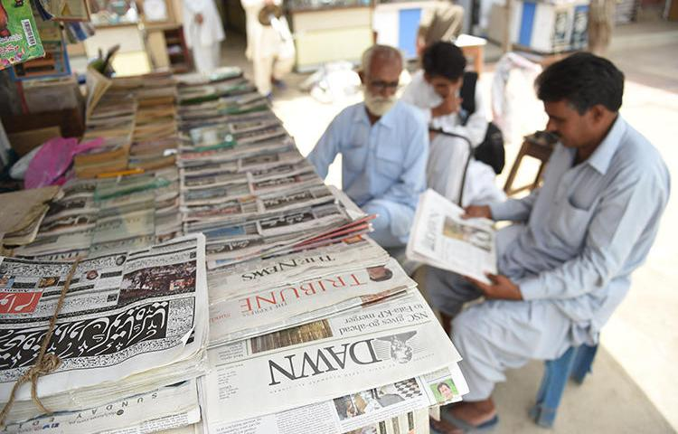 Newspapers are seen in Karachi, Pakistan, on May 20, 2018. The Pakistan government recently suspended advertising to two independent media groups. (AFP/Rizwan Tabassum)