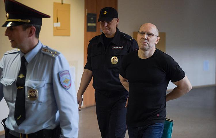 Journalist Igor Rudnikov is seen in Saint Petersburg, Russia, on June 17, 2019. Rudnikov was released from prison last year, but has faced opposition from local Kaliningrad officials and is struggling to continue publishing his paper. (AFP/Olga Maltseva)