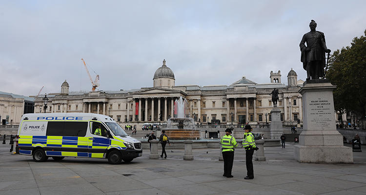 Police officers are seen around Trafalgar Square in London on October 15, 2019. A U.K. agency recently released a report detailing surveillance efforts involving journalists. (AFP/Isabel Infantes)