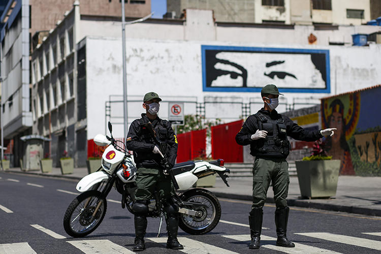 Members of the Bolivarian National Guard wearing face masks are seen in Caracas, Venezuela, on March 17, 2020. Journalists have recently been harassed and detained over their reporting on the virus. (AFP/Cristian Hernandez)