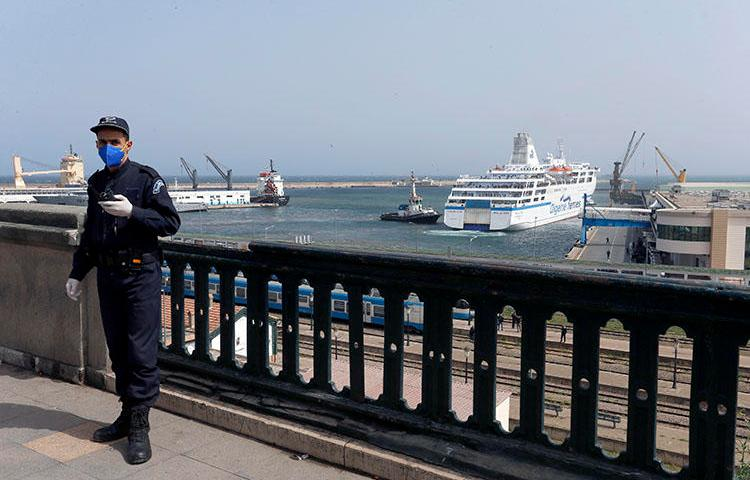 A police officer is seen in Algiers, Algeria, on March 19, 2020. Algerian authorities recently imprisoned journalist and RSF correspondent Khaled Drareni. (AP/Toufik Doudou)