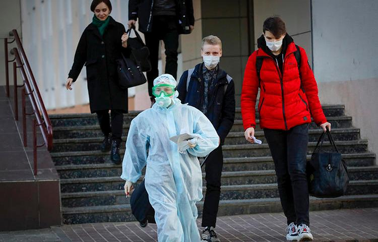 A medical worker is seen in Minsk, Belarus, on March 13, 2020. Journalist Siarhei Satsuk was recently detained on bribery charges after publishing reporting on COVID-19. (AP/Sergei Grits)