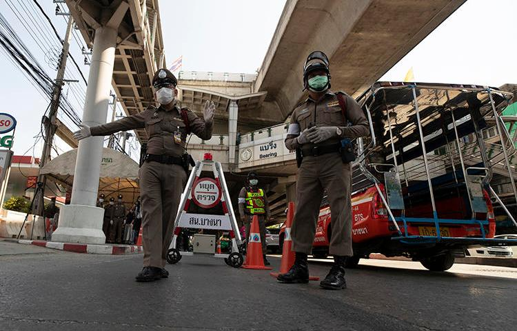 Police officers are seen in Bangkok, Thailand, on March 26, 2020. The Thai government has imposed a state of emergency in response to the COVID-19 outbreak, and has restricted the press. (AP/Sakchai Lalit)