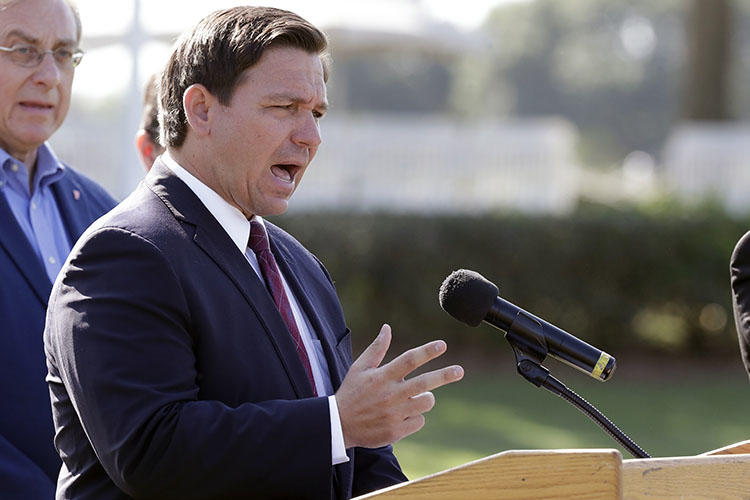 Florida Governor Ron DeSantis is seen in The Villages, Florida, on March 23, 2020. Authorities at the Florida State Capitol recently barred journalist Mary Ellen Klas from attending a news briefing by DeSantis. (AP/John Raoux)