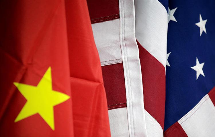 U.S. and Chinese flags are seen in Beijing, China, on May 28, 2019. The U.S. State Department recently announced a cap on visas for five Chinese state media outlets. (Reuters/Jason Lee)
