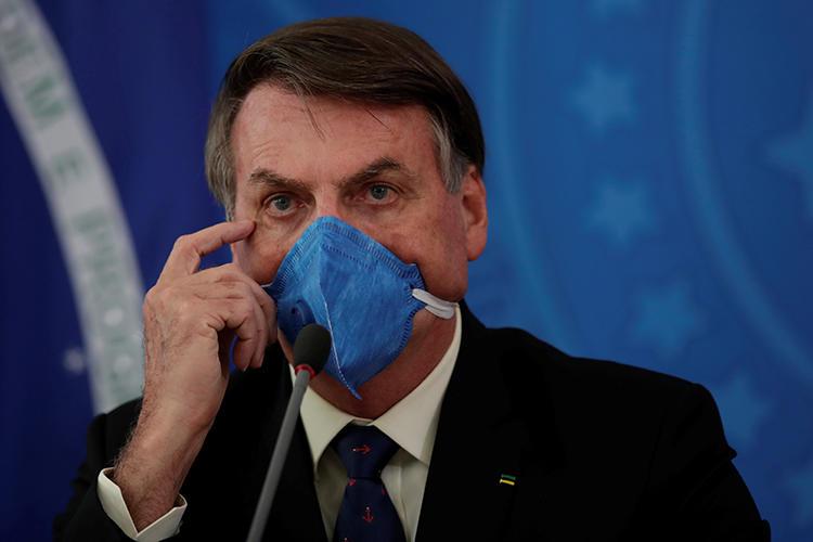 O presidente brasileiro é visto em Brasília em 20 de março de 2020. Jair Bolsonaro aprovou recentemente uma medida provisória restringindo o acesso a registros públicos. (Reuters / Ueslei Marcelino)