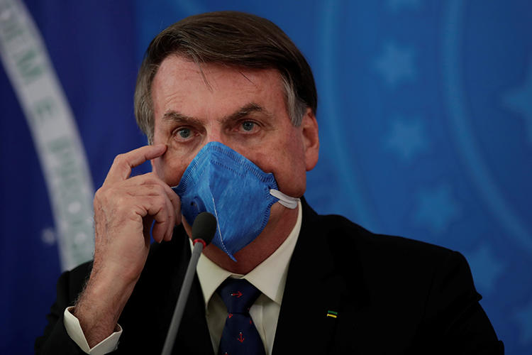 Brazilian President Jair Bolsonaro is seen in Brasilia on March 20, 2020. Bolsonaro recently passed a provisional regulation restricting access to public records. (Reuters/Ueslei Marcelino)