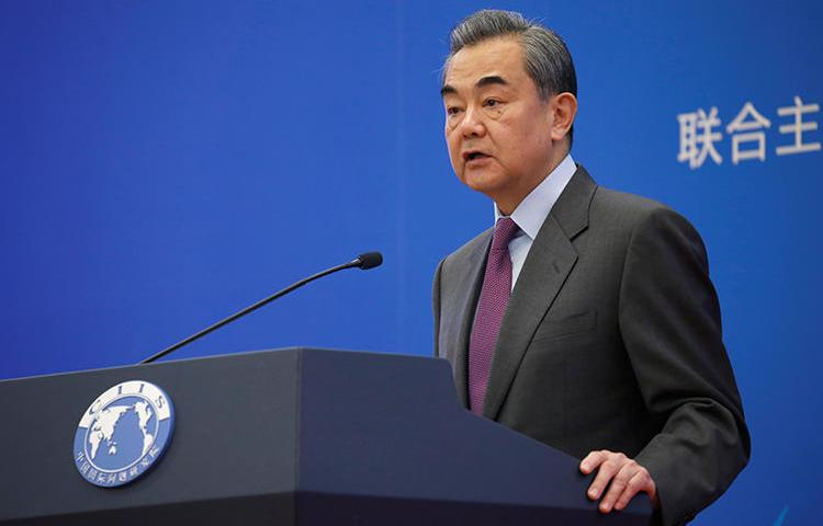 Chinese Foreign Minister Wang Yi is seen in Beijing on December 13, 2019. The Chinese Ministry of Foreign Affairs today announced that U.S. journalists at three major outlets would have their press credentials cancelled. (Reuters/Jason Lee)