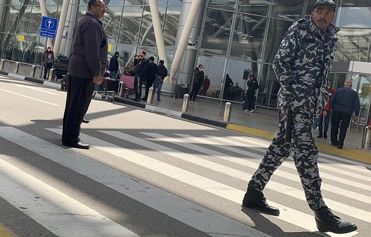 A police officer is seen at Cairo International Airport in Cairo, Egypt, on March 19, 2020. Egypt recently expelled Guardian reporter Ruth Michaelson over her reporting on the COVID-19 outbreak. (Reuters/Amr Abdallah Dalsh)